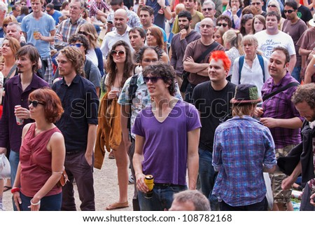 BRISTOL, ENGLAND - JULY 21: Audience at the front of the Queen Square stage at the Harbour Festival in Bristol, England on July 21, 2012. The three day free festival played host to 300,000 spectators