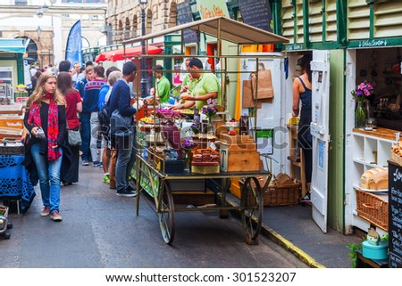 BRISTOL, ENGLAND - JULY 08, 2015: St Nicolas Market with unidentified people. Its located on Corn Street, in The Exchange and is also home to Bristol Farmers Market, Nails Market, and Slow Food Market