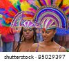 BRISTOL, ENGLAND - JULY 2: Two colourful participants in the annual Afrikan Caribbean carnival in St Pauls Bristol, England on July 2, 2011. A record crowd of 80,000 attended the street event - stock photo