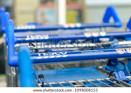 Bristol, England - May 24, 2018: Close up of TESCO shopping trolley - blue handles, shallow depth of field