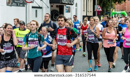 Bristol, England - 13 SEPTEMBER 2015 Bristol Half Marathon 2015 - runners 25533, 25976 and others (unidentified runners)