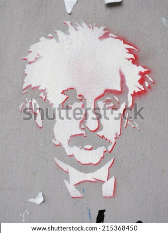 BRISTOL - MAR 18: View of a stencil graffiti piece of Albert Einstein by an unidentified artist seen on a city centre wall on Mar 18, 2011 in Bristol, UK. Bristol renowned for its vibrant street art. - stock photo