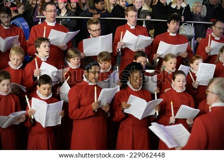 BRISTOL - NOV 7: Bristol Cathedral Choir peform in Cabot Circus shopping mall on Nov 7, 2014 in Bristol, UK. The choir performed traditional Christmas carols for visitors to the mall. - stock photo