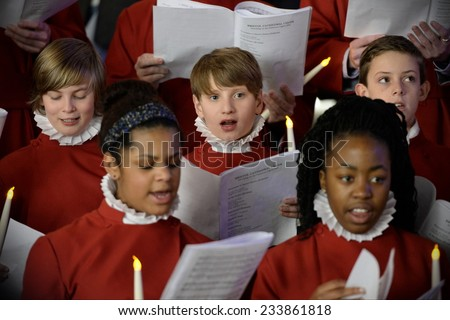 BRISTOL - NOV 7: Bristol Cathedral Choir perform in Cabot Circus shopping mall on Nov 7, 2014 in Bristol, UK. The choir peformed traditional Christmas carols for visitors to the mall.  - stock photo