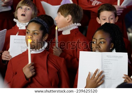 BRISTOL - NOV 7: Bristol Cathedral Choir perform in Cabot Circus shopping mall on Nov 7, 2014 in Bristol, UK. The choir performed traditional Christmas carols for visitors to the mall.  - stock photo