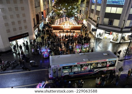 BRISTOL - NOV 7: People visit Broadmead during the Christmas holiday shopping season on Nov 7, 2014 in Bristol, UK. Broadmead is the city's principal shopping district. - stock photo