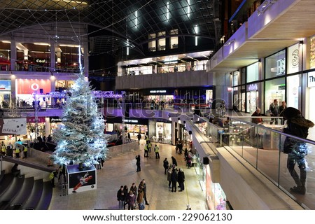 BRISTOL - NOV 7: People visit Cabot Circus shopping mall during the Christmas holiday shopping season on Nov 7, 2014 in Bristol, UK. The mall boasts 1,000,000 sq ft of retail and leisure outlets. - stock photo