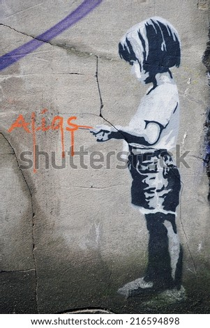 BRISTOL - NOV 8: View of a stencil graffiti piece by Alias on a wall in the city centre on Nov 8, 2010 in Bristol, UK. Bristol is renowned for its vibrant and political street art scene. - stock photo