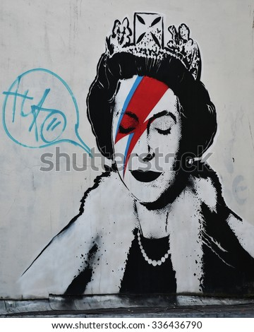 BRISTOL - OCT 31: View of a Banksy piece depicting the Queen as Ziggy Stardust seen on a city centre street on Oct 31, 2015 in Bristol, UK. Banksy is a world renowned street artist from Bristol. - stock photo