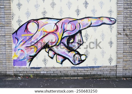 BRISTOL - OCT 22: View of a graffiti piece by an unidentified artist on a city centre wall on Oct 22, 2010 in Bristol, UK. Bristol is famous for its vibrant graffiti and street art scene. - stock photo