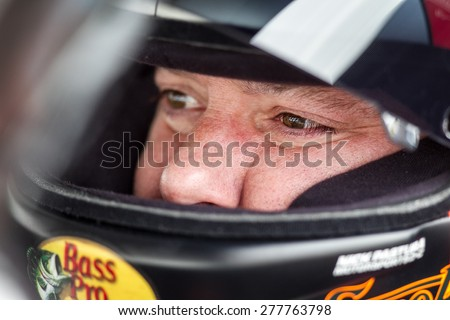 Bristol, TN - Apr 17, 2015:  Tony Stewart (14) straps into his race car before the Food City 500 at Bristol Motor Speedway in Bristol, TN. - stock photo
