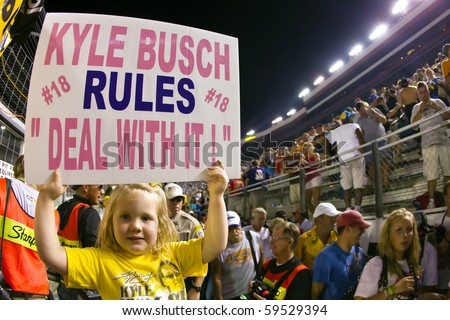 BRISTOL, TN - AUG 21:  5 year old Harper Stiner shows her support for Kyle Busch as he wins all three races at the Bristol Motor Speedway in Bristol, TN on Aug 21, 2010. - stock photo
