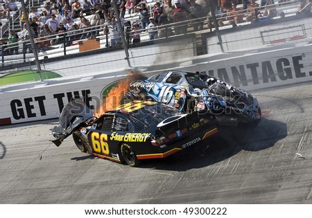 BRISTOL, TN - MAR 20: Steve Wallace and Colin Braun collide during the running of the Scotts Turf Builder 300 race at the Bristol Motor Speedway on Mar 20, 2010 in Bristol, TN.