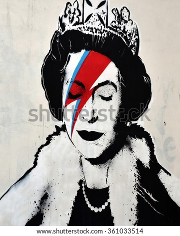 BRISTOL, UK - AUG 21, 2015: View of a Bansky piece depicting David Bowie's Ziggy Stardust persona as the Queen seen on a city centre street. Banksy is a world renowned street artist from Bristol. - stock photo