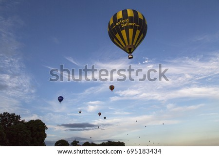 Bristol, UK: August 13, 2016: The annual event has become Europe's largest hot air balloon festival. Spectators surround the main attraction as all the balloons lift off for the evening Mass Ascent.