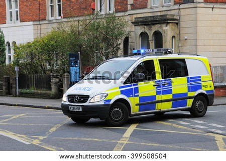 Bristol, UK - February 24, 2011: A police Vehicle responds to an emergency on a city centre street. - stock photo