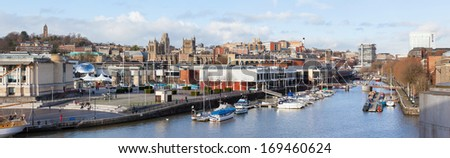 BRISTOL, UK - JANUARY 2, 2014 : Panoramic view of St Augustine's Reach in Bristol Harbour on 2nd Jan 2014. The view includes city attractions including Cabot's Tower, At-Bristol and Bristol Cathedral. - stock photo