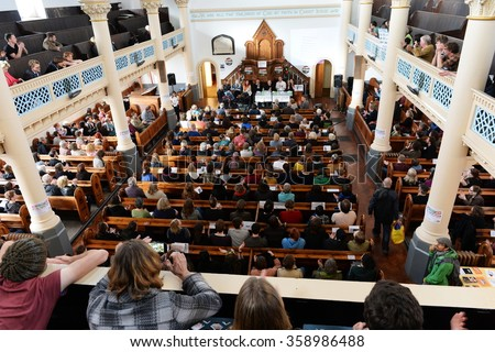 BRISTOL, UK - MAY 18, 2015: The People's Assembly Against Austerity meet in a church to plan activism after the conservative party's re-election. The government plan extensive cuts to public services. - stock photo