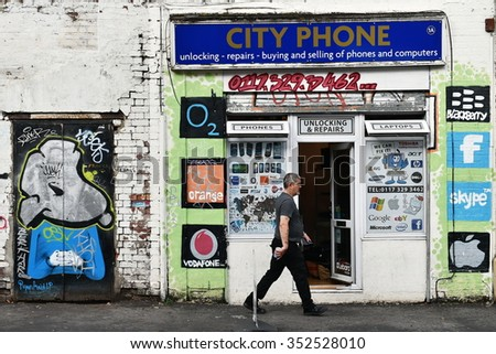 BRISTOL, UK - OCT 31, 2015: View of a mobile phone and computer repair shop decorated by street art. The west country city is famous for its vibrant graffiti and street art.