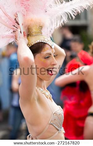 Bristol, UK. 5th July 2014. Dance troop celebrate St. Paul's Carnival - stock photo