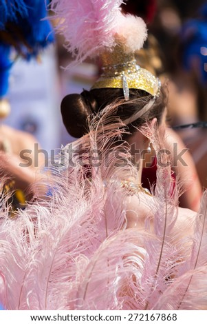 Bristol, UK. 5th July 2014. Girl wearing plumes and feathers at St. Paul's carnival - stock photo
