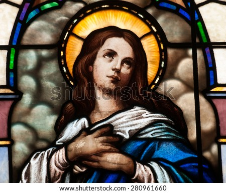 BRISTOW, VIRGINIA - APRIL 26, 2015: Stained glass window depicting the Blessed Virgin Mary in the chapel of St. Benedict Monastery - stock photo