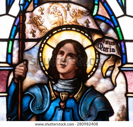 BRISTOW, VIRGINIA - APRIL 26, 2015: Stained glass window of close up of St. Joan of Arc, located in chapel of St. Benedict Monastery