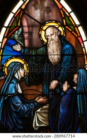 BRISTOW, VIRGINIA - APRIL 26, 2015: Stained glass window of Saint Benedict and his twin sister, St. Scholastica, located in chapel of St. Benedict Monastery - stock photo