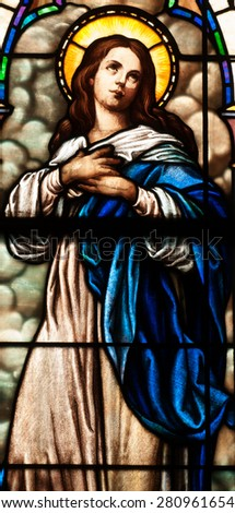 BRISTOW, VIRGINIA - APRIL 26, 2015: Stained glass window of the Blessed Virgin Mary in chapel of St. Benedict Monastery - stock photo