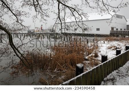 Britannia Heritage Shipyards Winter, Richmond. Winter snow at the historic Brittania Heritage shipyard on the banks of the Fraser River in Steveston, British Columbia, Canada.  - stock photo
