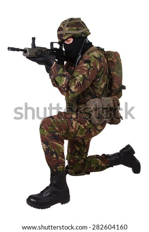 British Army Soldier with assault rifle isolated on white - stock photo