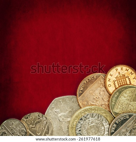 British coins over red grunge background. - stock photo