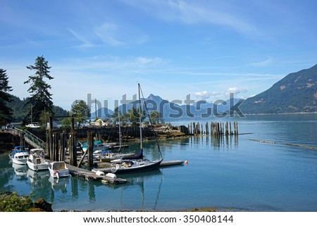 British Columbia, Pacific coast inlet with small boats - stock photo