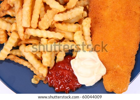 British cuisine: Fish and chips with ketchup and mayonnaise