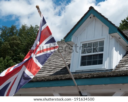 British flag fluttering in front of an old building