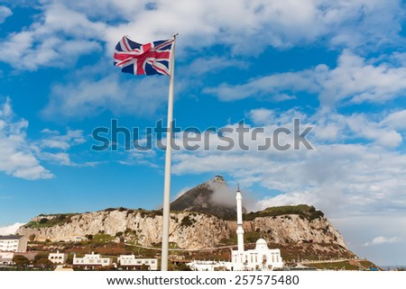 British flag on a background of Ibrahim-al-Ibrahim Mosque at Europa Point, Gibraltar - stock photo