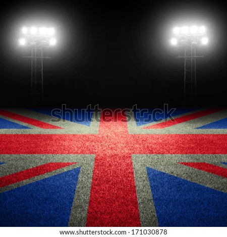 British flag on field against illuminated stadium lights - stock photo