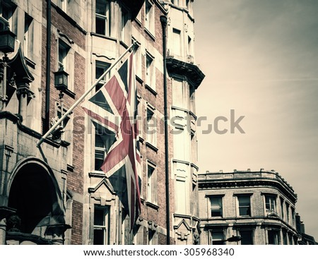 British flag on the building. London, UK. Toned image. - stock photo