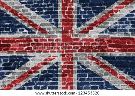 British flag on the old brick wall - stock photo