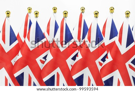British flags hanging on the gold flagpole, Isolated on the white background - stock photo
