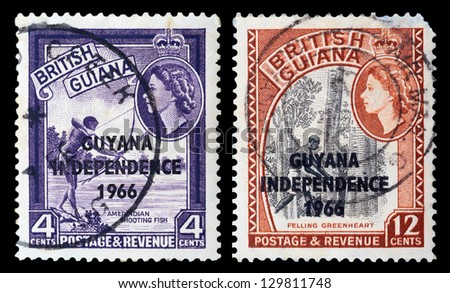 BRITISH GUIANA - CIRCA 1966: A set of postage stamps printed in BRITISH GUIANA shows Amerindian shooting fish and felling greenheart, series, circa 1966