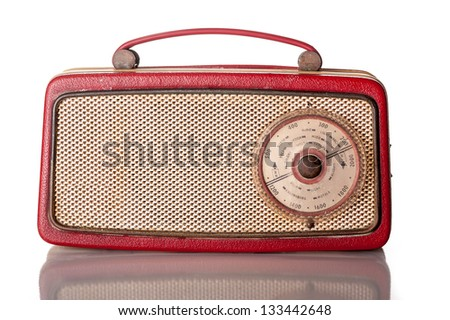 British made sixties transistor radio, red body with brass grille - isolated on white - stock photo