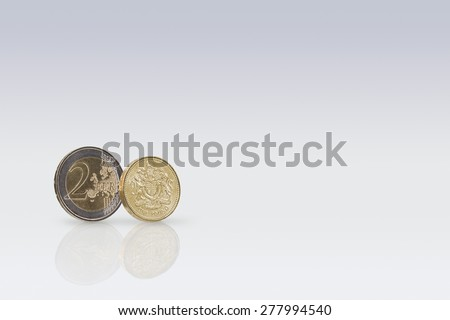 British One Pound coin And Two Euro coin - stock photo