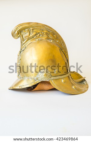 British Other Ranks Merryweather Brass Fire Helmet, used during the blitz, Second World War, with consequent damage - stock photo