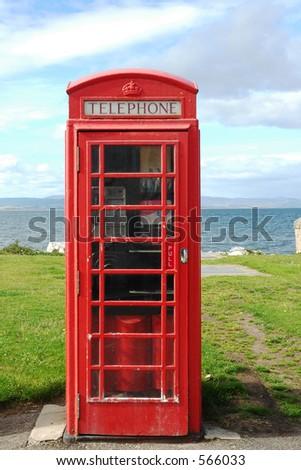 British phone box in Scottish fishing village - stock photo