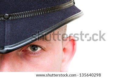 british policeman wearing helmet with copy space - stock photo