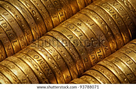 British Pound Coins side view suitable for backgrounds - stock photo