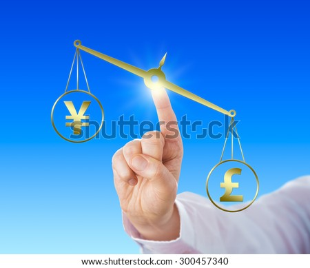 British Pound Sterling symbol is outweighing the Japanese Yen currency sign on a golden scale. Index finger of a white collar worker is touching the balance. Financial metaphor for forex trading. - stock photo