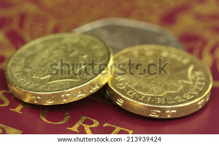 British Pound with bank notes with passport - stock photo