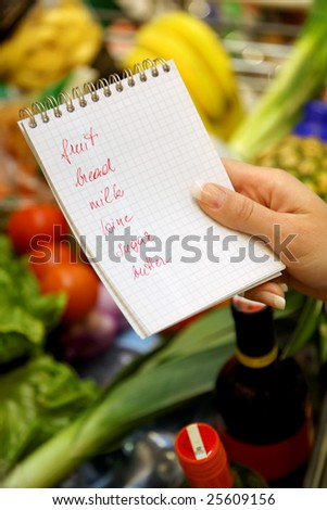 British shopping list in a supermarket with a shopping trolley - stock photo